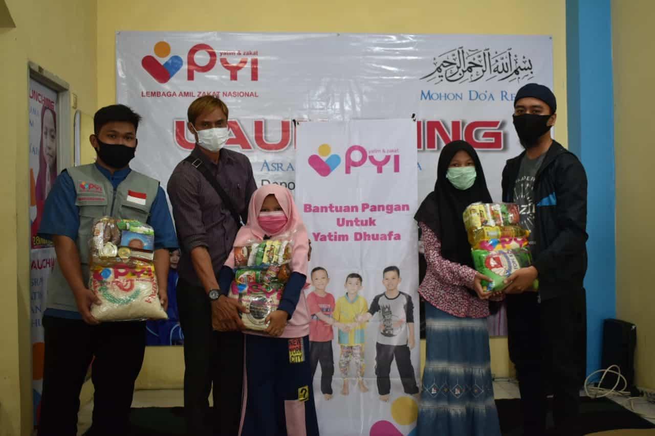 Penyaluran paket sembako untuk yatim dan Dhuafa
